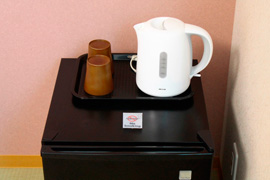 mini-fridge, kettle, and cups